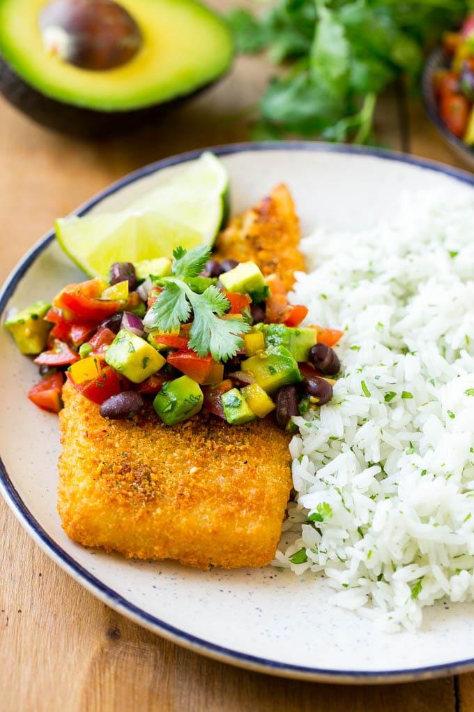 A fajita fish fillet served with cilantro lime rice and avocado salsa.