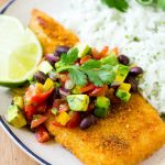 This fajita fish is baked to crispy perfection and topped with a colorful and refreshing avocado salsa. A quick and easy dinner that the whole family will love!
