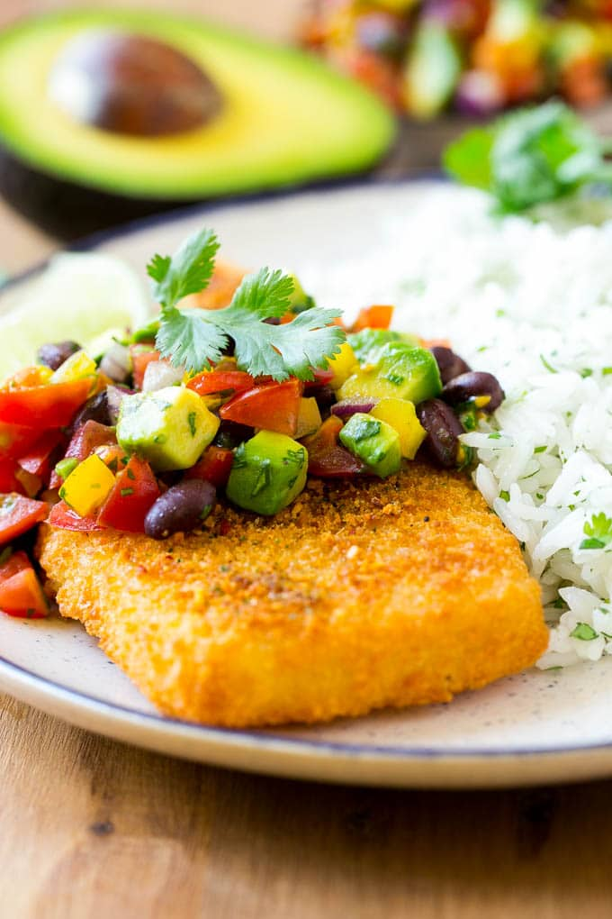 Crispy fish topped with avocado and black bean salsa.