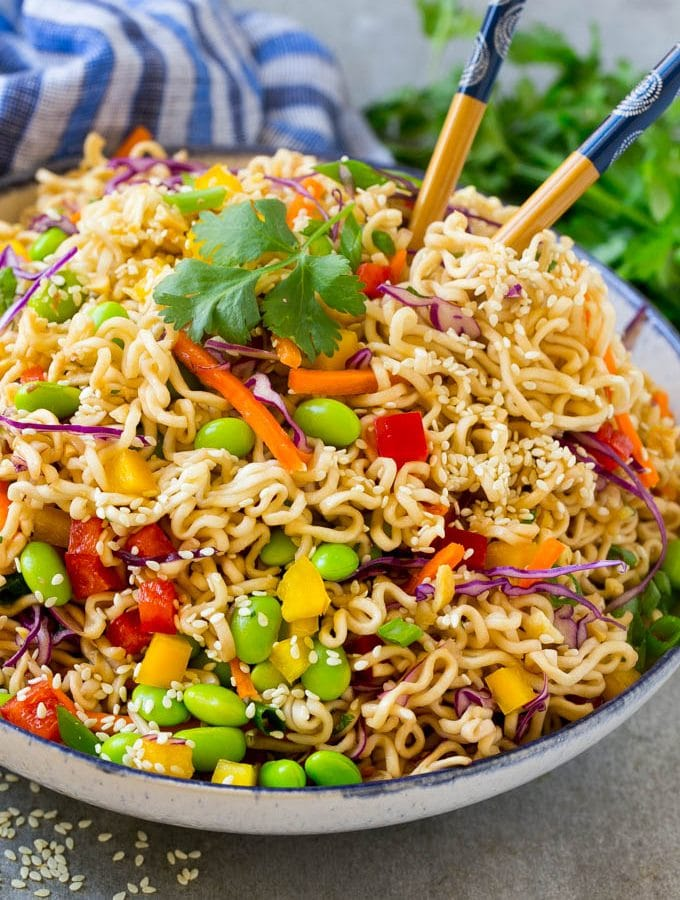 This easy Asian noodle salad recipe is ramen noodles and colorful veggies all tossed in a sesame hoisin dressing. The perfect side dish for any summer celebration!