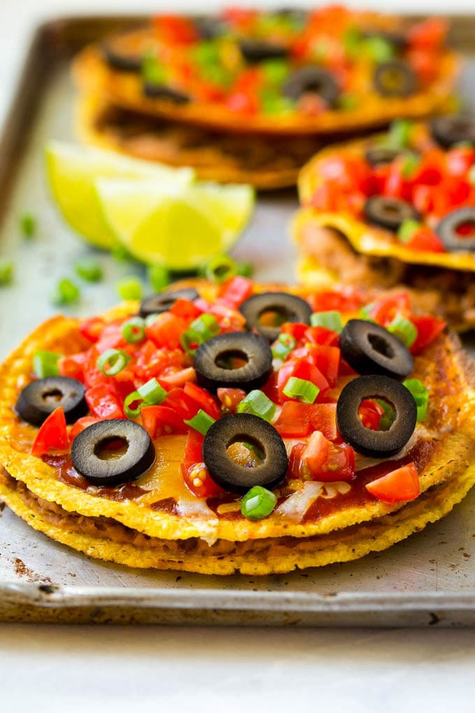 Taco meat and beans layered between tostadas to make Mexican pizza.