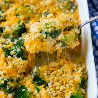 A spoonful of cheesy broccoli casserole