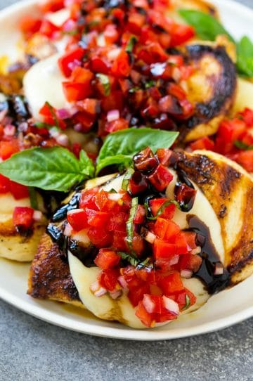 Grilled bruschetta chicken topped with melted mozzarella cheese, tomato basil bruschetta and a drizzle of balsamic glaze.