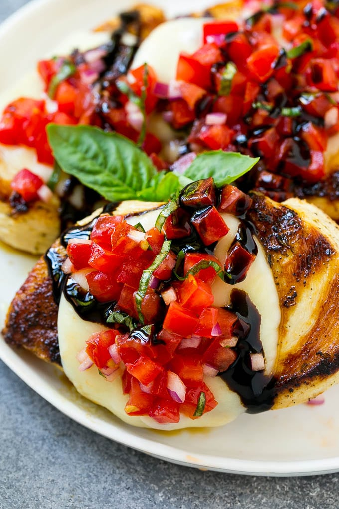 Bruschetta chicken with mozzarella cheese, tomatoes and balsamic glaze.