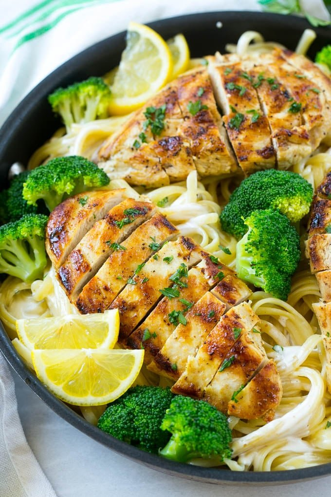A pan of chicken and broccoli pasta in a creamy lemon sauce.