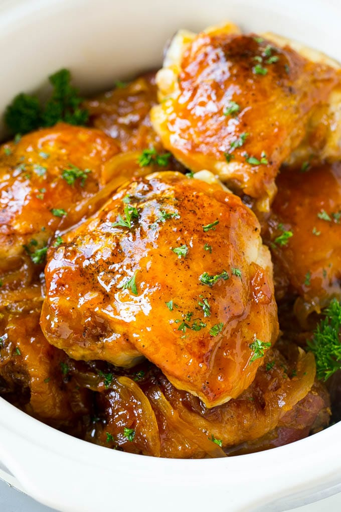 A close up of slow cooker apricot chicken topped with parsley.