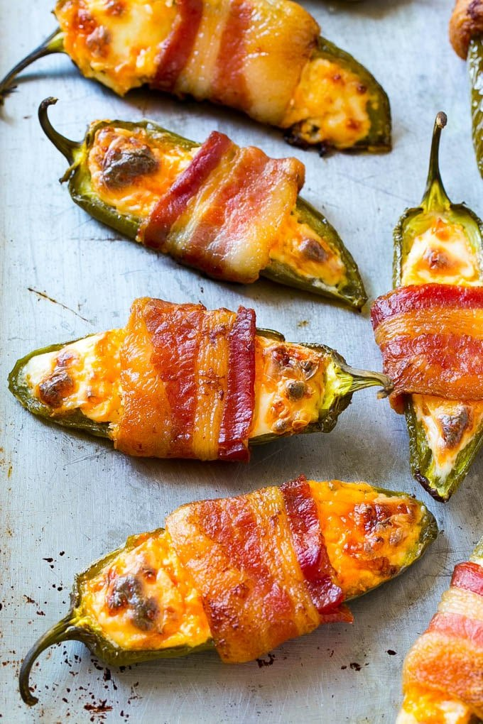 A sheet pan with bacon wrapped jalapeno poppers.