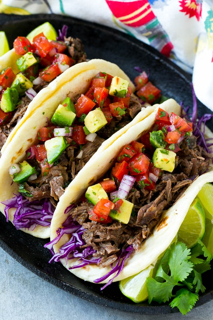 A plate of barbacoa beef tacos.