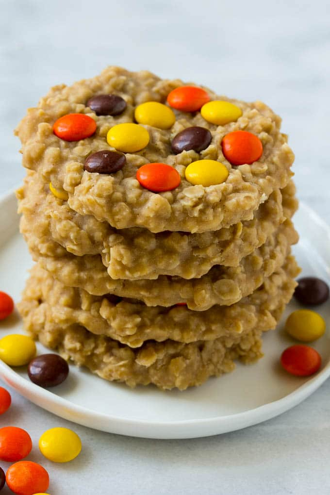 A plate with a stack of no bake peanut butter cookies.