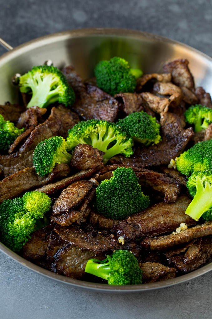 Steal and broccoli florets in a skillet.