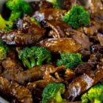 Beef and broccoli stir fry in a pan.