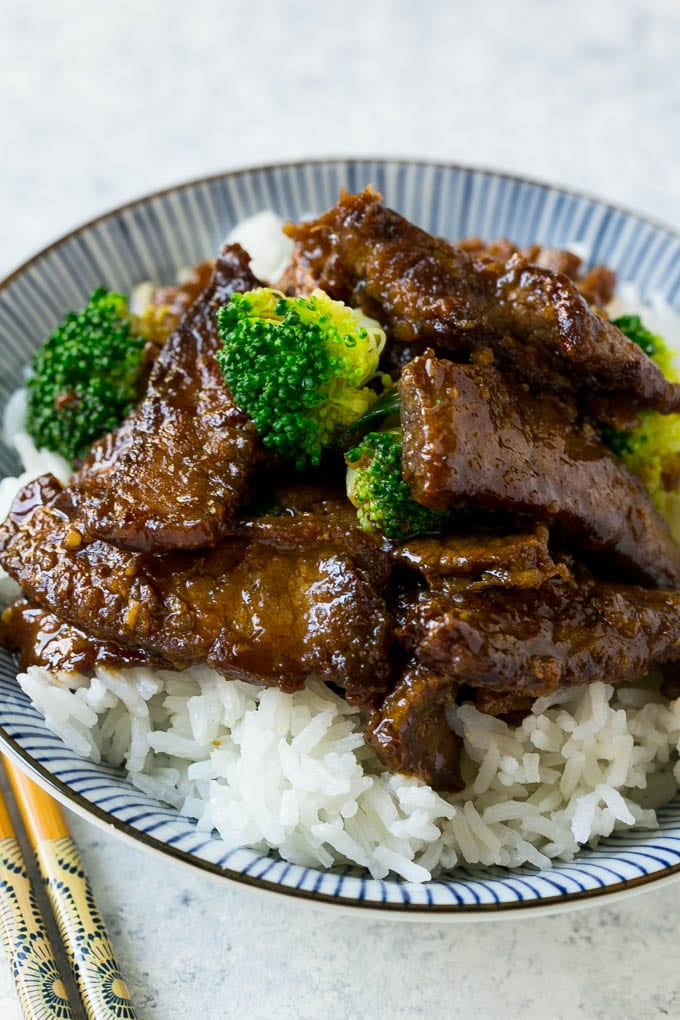 A bowl of beef and broccoli stir fry over rice.