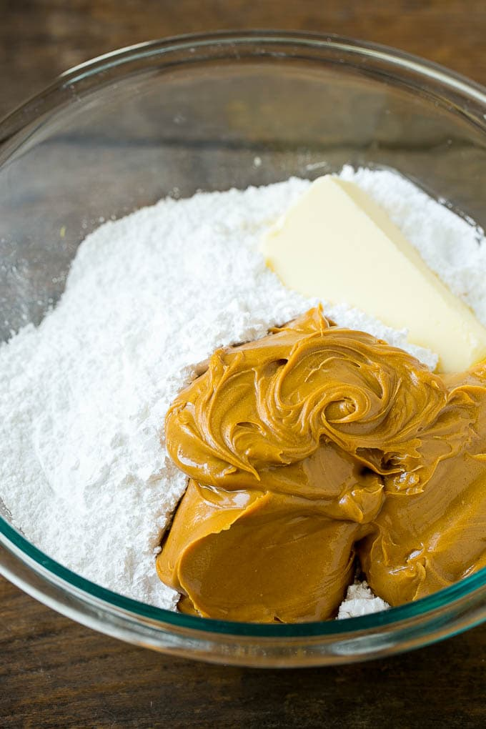 Peanut butter, powdered sugar and butter in a mixing bowl.