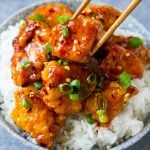 A bowl of sweet and spicy firecracker chicken.