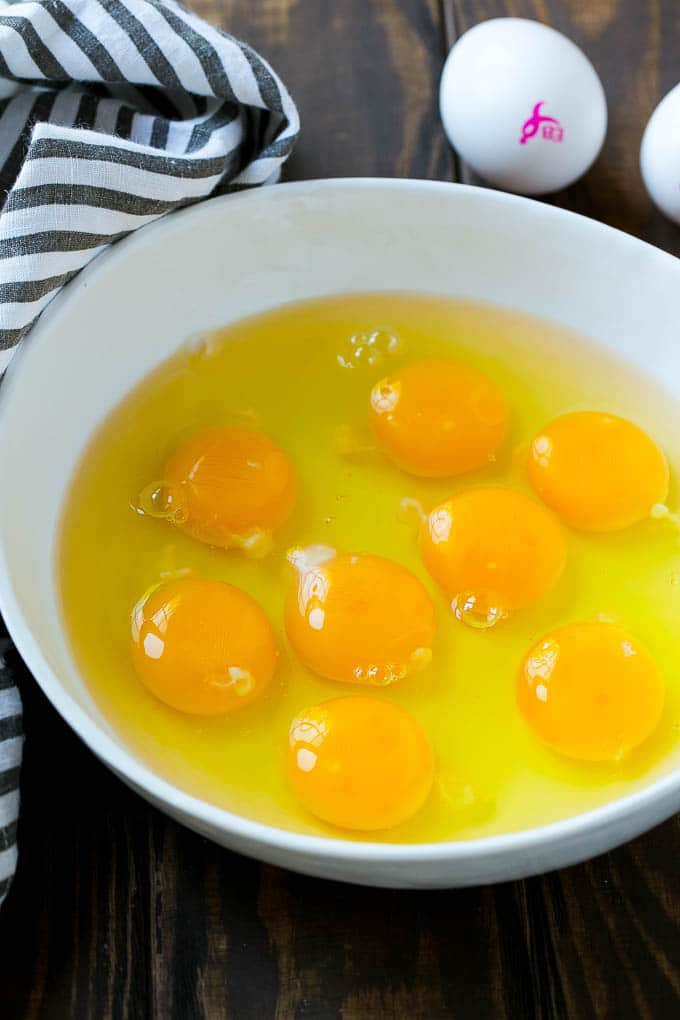 Eggs for Ham and Egg Casserole in a mixing bowl.