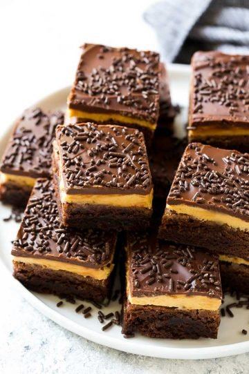 Peanut butter brownies with a chocolate brownie base, peanut butter frosting and fudge topping.
