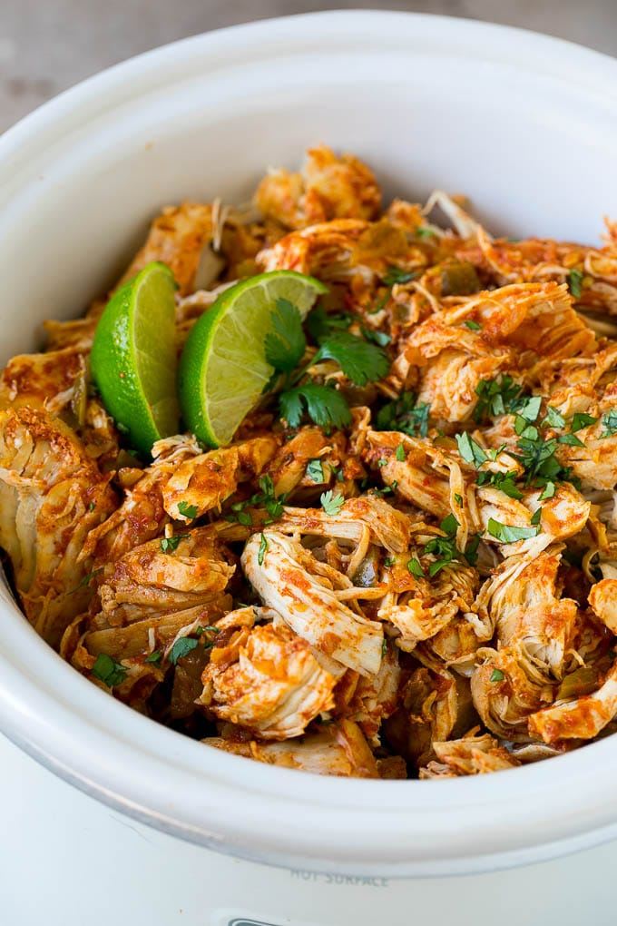 Shredded Mexican chicken in a crock pot.