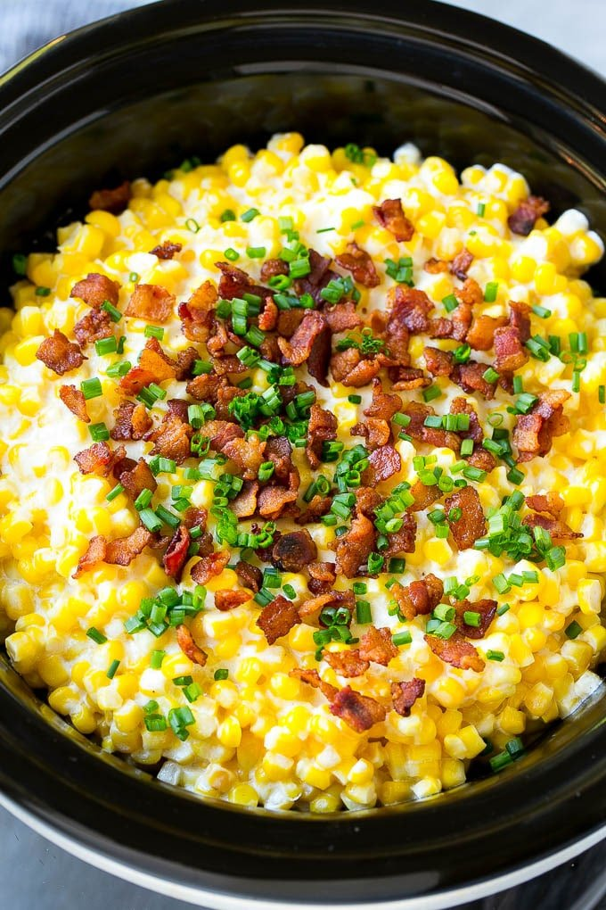 Slow Cooker Creamed Corn topped with bacon and chives.