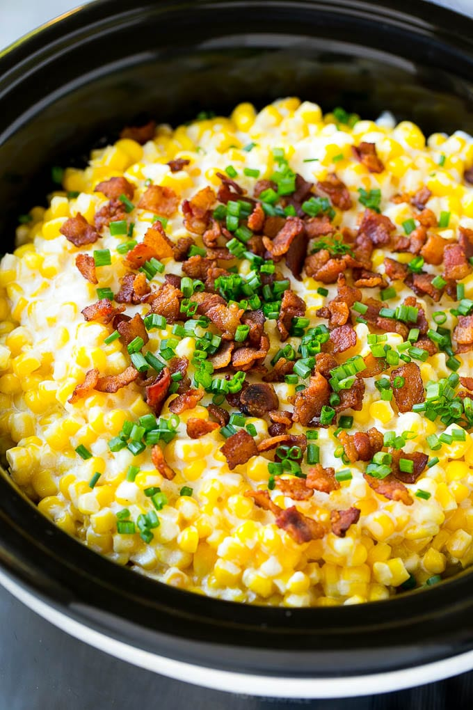 Slow Cooker Creamed Corn with Bacon and sliced chives.