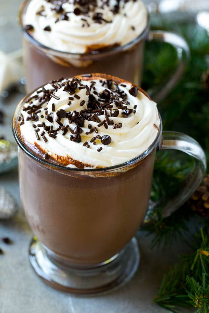 A mug of slow cooker hot chocolate topped with whipped cream.