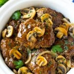 Slow cooker salisbury steak with mushroom gravy and onions.