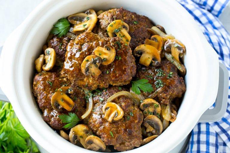 A crock pot full of slow cooker salisbury steak.