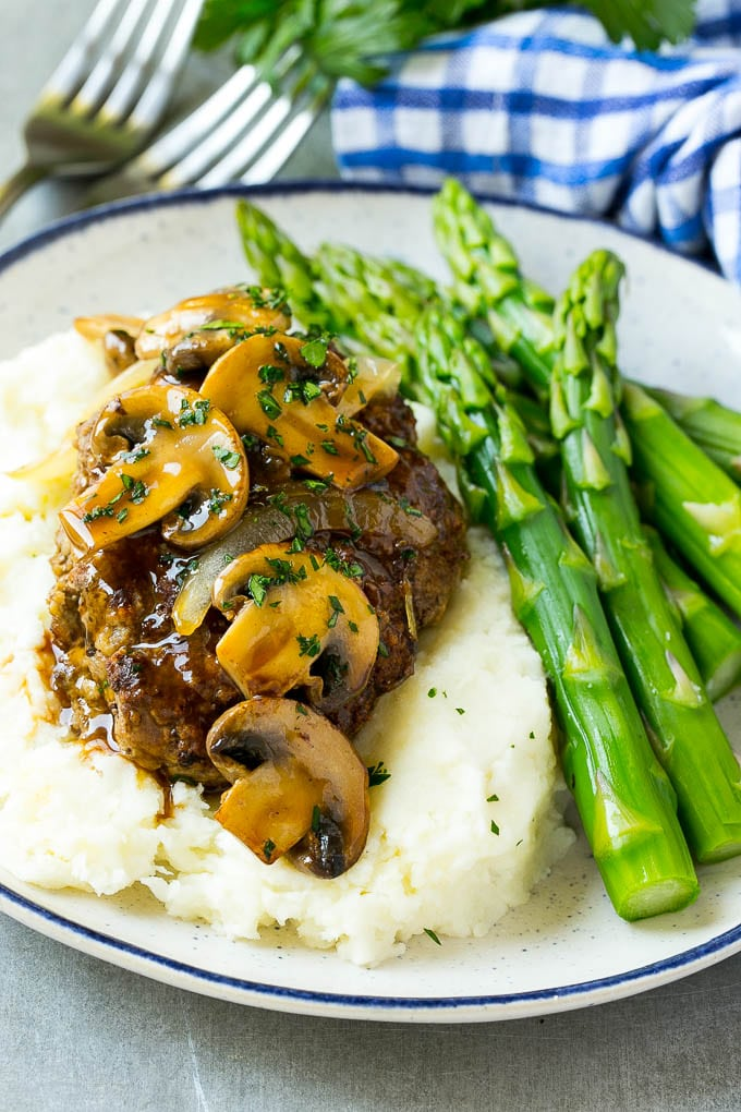 Slow cooker salisbury steak with mushroom gravy over mashed potatoes.