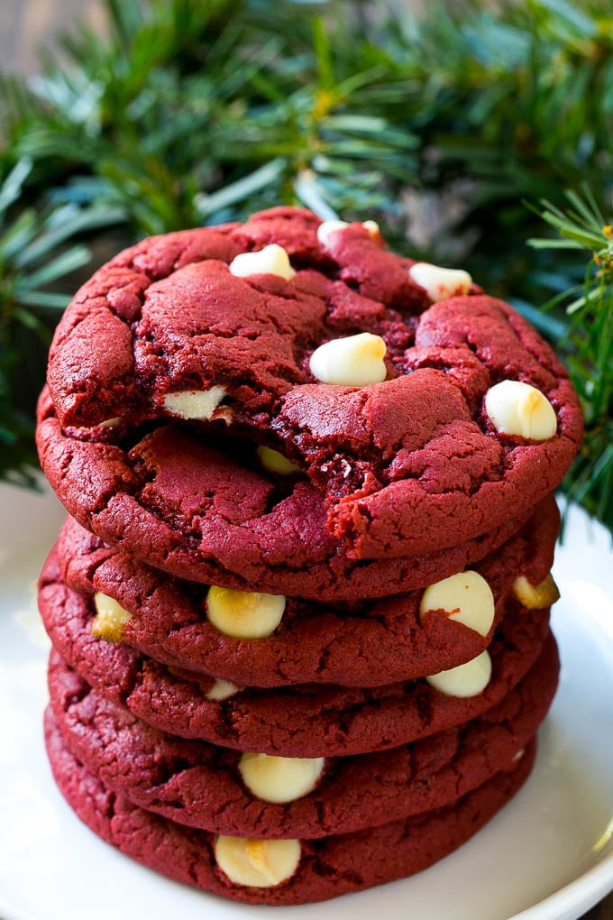 A stack of red velvet cookies on a plate.