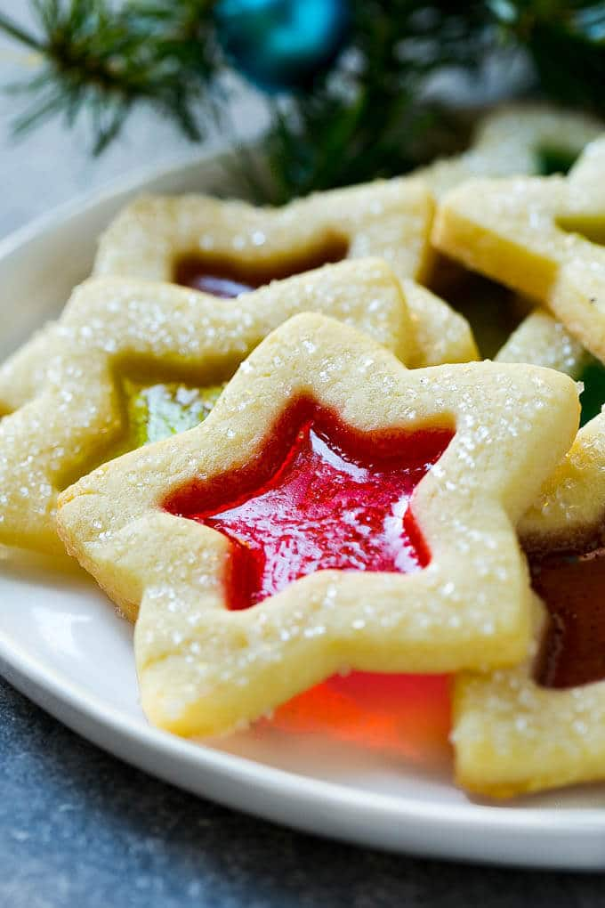 A star shaped stained glass cookie on a serving plate.