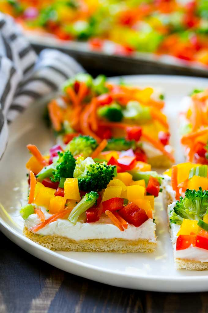 Vegetable Pizza is an appetizer made with cream cheese, crescent rolls and fresh veggies.