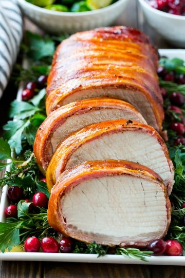 This bacon wrapped pork loin roast is brushed with a sweet and savory glaze, then covered in bacon and grilled to perfection.