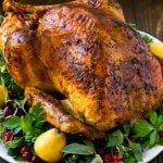 A whole herb roasted turkey is a show stopping main course for Thanksgiving or Christmas.
