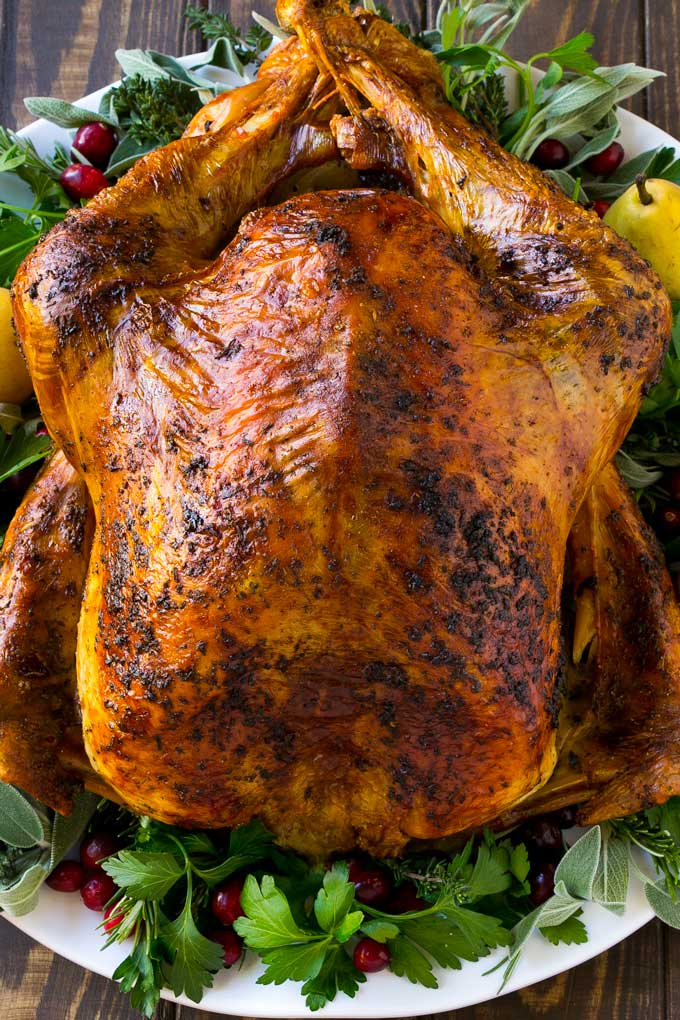 Herb roasted turkey is covered in butter and seasonings and baked to golden brown perfection.
