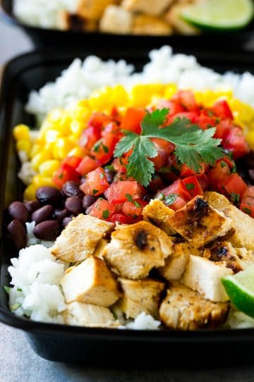These meal prep burrito bowls taste like they came from a restaurant, but you can easily make them at home and have a healthy and easy lunch all week long! They're full of grilled marinated chicken, cilantro lime rice, black beans, corn and fresh salsa.