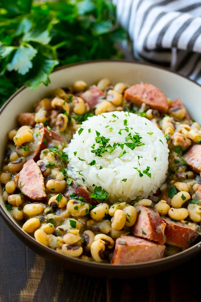 These slow cooker black eyed peas are loaded with ham, sausage and veggies. The perfect crock pot meal to get your new year off to the right start!