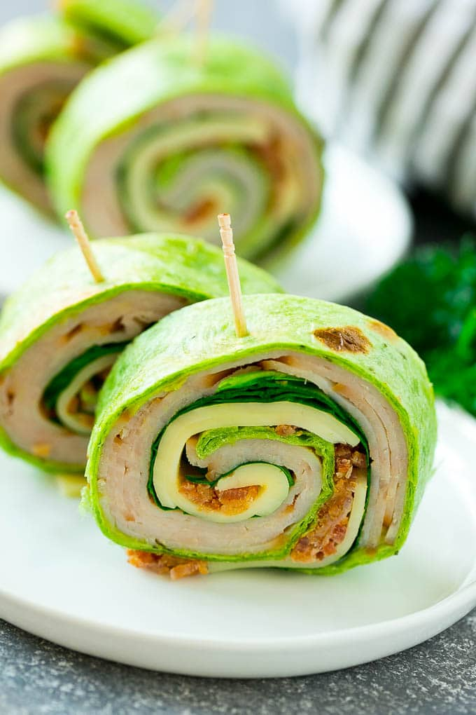 Turkey roll ups served on a plate.
