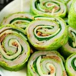 These turkey roll ups are pinwheel sandwiches filled with cheese, avocado, bacon, turkey and spinach.
