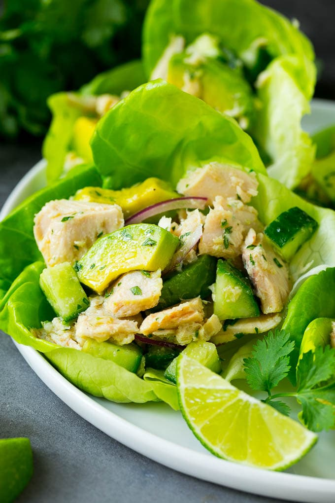 A lettuce cup holding a serving of avocado tuna salad.