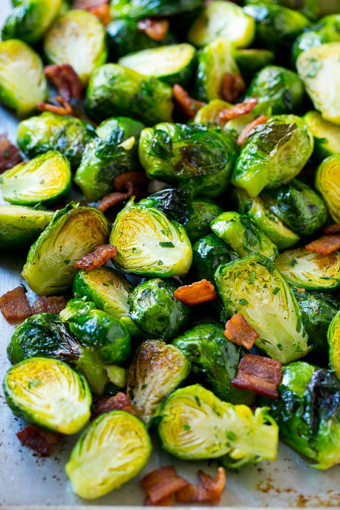 A sheet pan of oven roasted brussels sprouts and bacon.