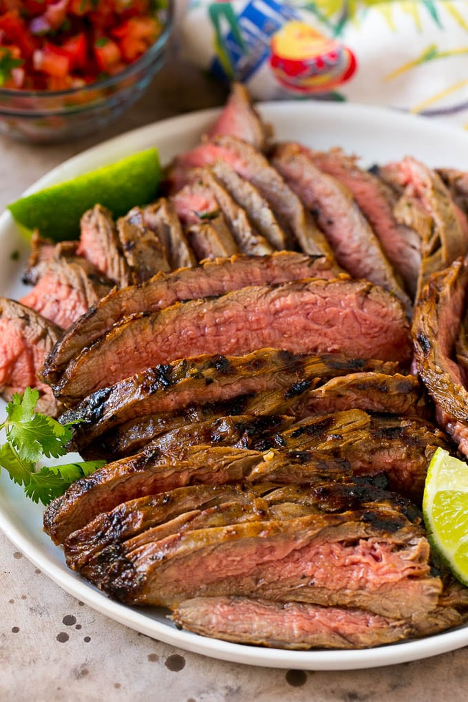 Thinly sliced carne asada steak on a serving plate.