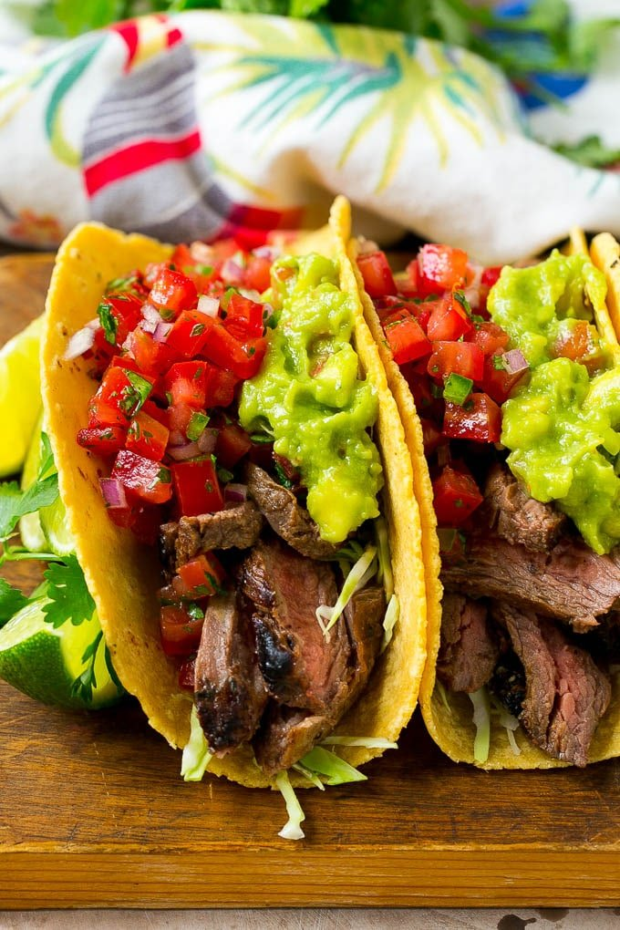 Carne asada tacos with grilled steak, cabbage, pico de gallo and guacamole.