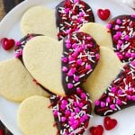 Heart cookies dipped in dark chocolate and decorated with Valentine's Day sprinkles.