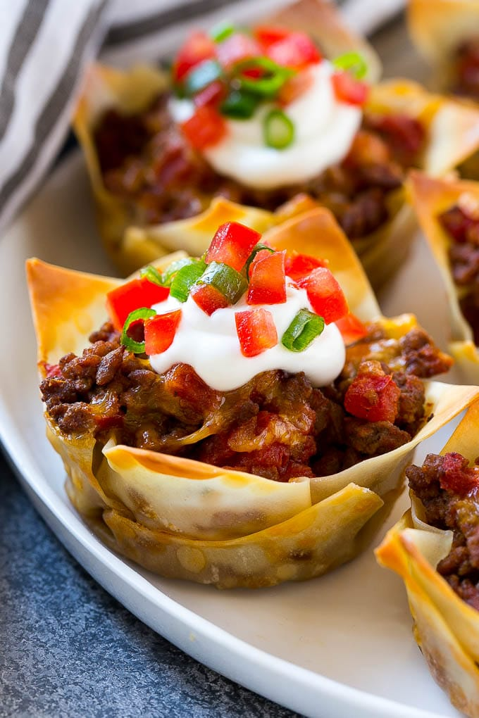 Taco cupcakes layered with wontons, seasoned meat and cheese, then baked to perfection.