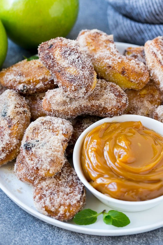 A platter of cinnamon sugar coated apple fries served with caramel dip.