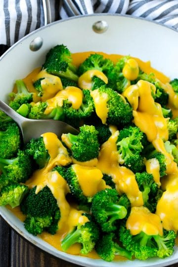 A pan of broccoli with cheese sauce that's full of steamed broccoli florets and homemade sauce.