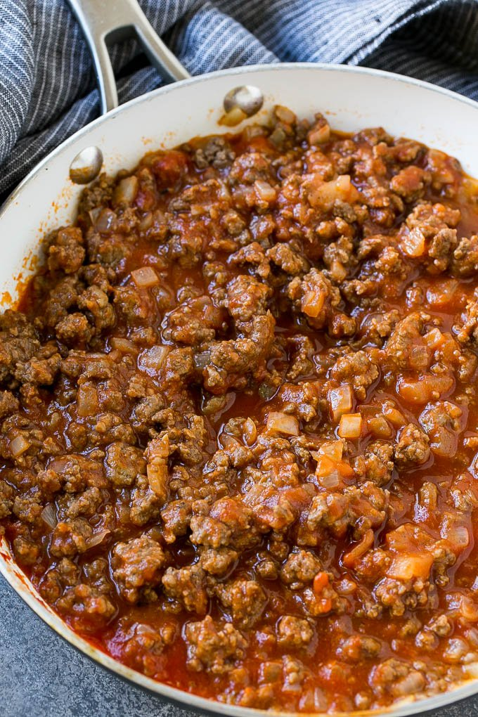 Seasoned ground beef and tomato sauce in a skillet.
