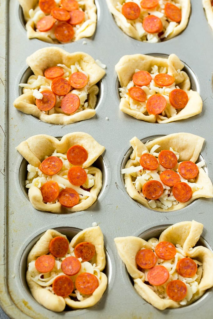 Unbaked pizza cups filled with cheese, sauce and pepperoni.