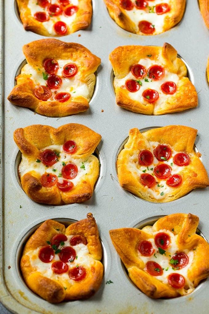 Pizza bites in a muffin tin.