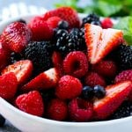 A berry salad with raspberries, blueberries, blackberries and strawberries all in a honey based dressing.
