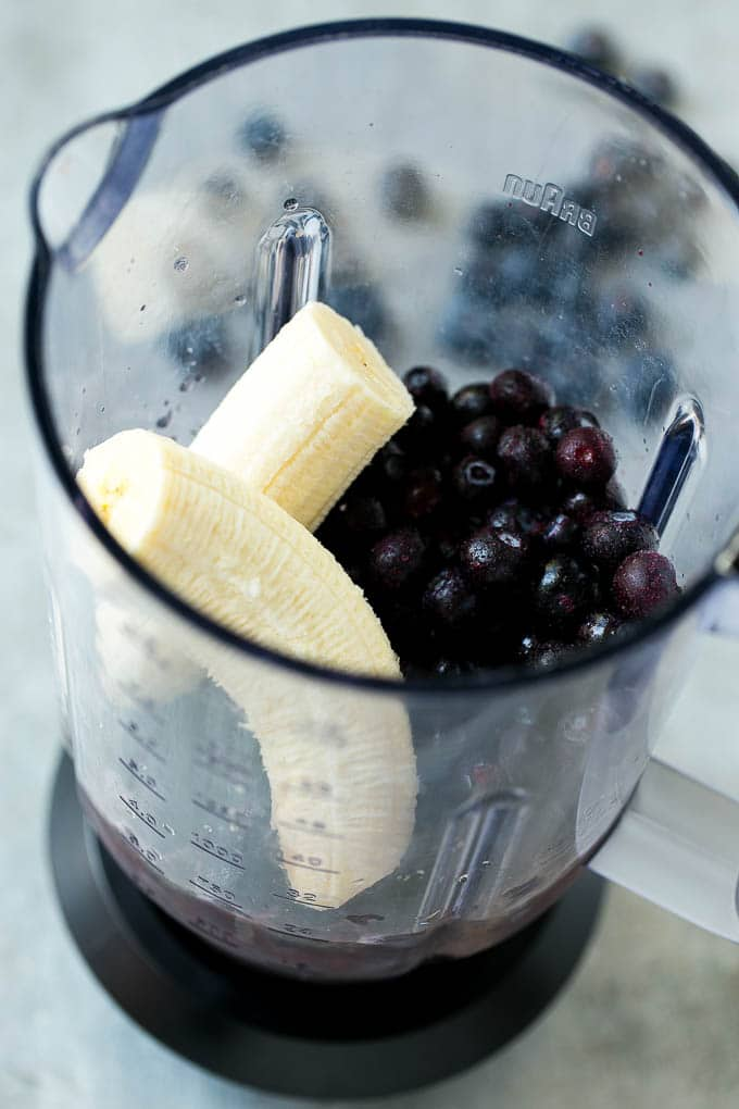 Blueberries, banana, juice and yogurt in a blender.
